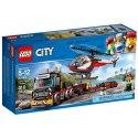 Vydej se na pracoviště za městem s tahačem na přepravu těžkého nákladu LEGO City.Připoj přívěs za tahač a odvez vrtulník na další opravy.